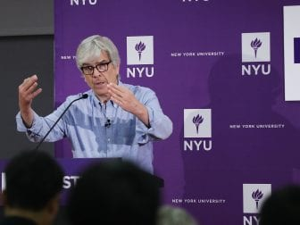 New York University (NYU) professor Paul Romer speaks at a news conference after being named a winner of the 2018 Nobel Prize in Economics with professor William D. Nordhaus of Yale University.