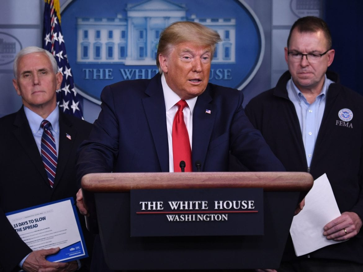 President Trump, flanked by FEMA Administrator Peter Gaynor, right, and Vice President Mike Pence, speaks during a daily briefing on the coronavirus.