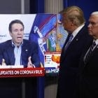 Some 78% of New York voters say they trust Gov. Andrew Cuomo to decide when to reopen their state, compared to 16% who say they trust President Trump. Here, Trump and Vice President Mike Pence watch a video of Cuomo speaking, during a coronavirus task force briefing at the White House last week.