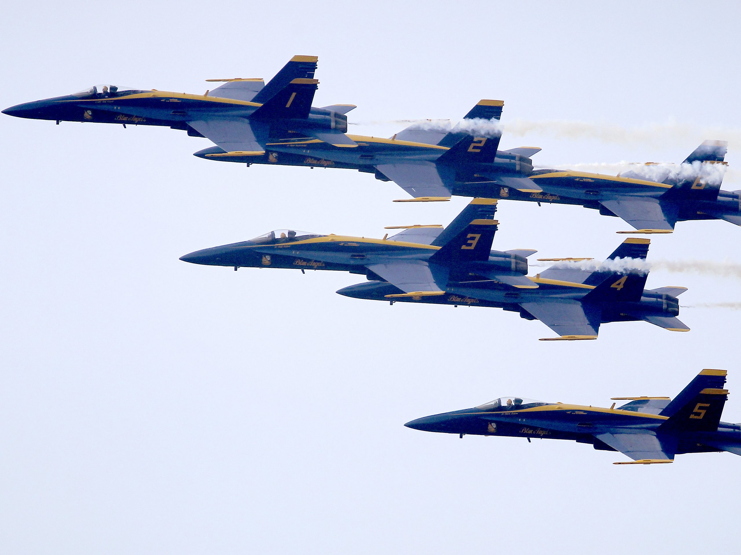 """The U.S. Navy and U.S. Air Force will conduct """"a collaborative salute"""" with a flyover above cities in New York, New Jersey and Pennsylvania on Tuesday. In this 2015 photo the U.S. Navy Blue Angels do a flyover at the Arnold Palmer Invitational golf tournament in Orlando, Fla."""