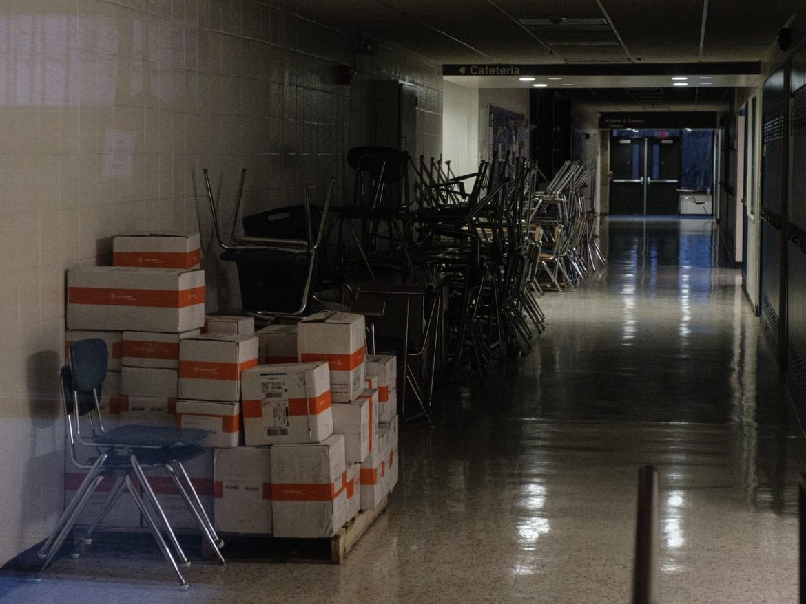 Chairs sit stacked in a hallway at a closed school in New Rochelle, N.Y., outside New York City. New Rochelle was an early hot spot in the state's battle against the coronavirus.