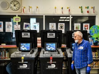 An election worker at a poling station in Miami during last month's election there. The coronavirus pandemic is challenging election officials, whose own staffers are coming sick with the virus.