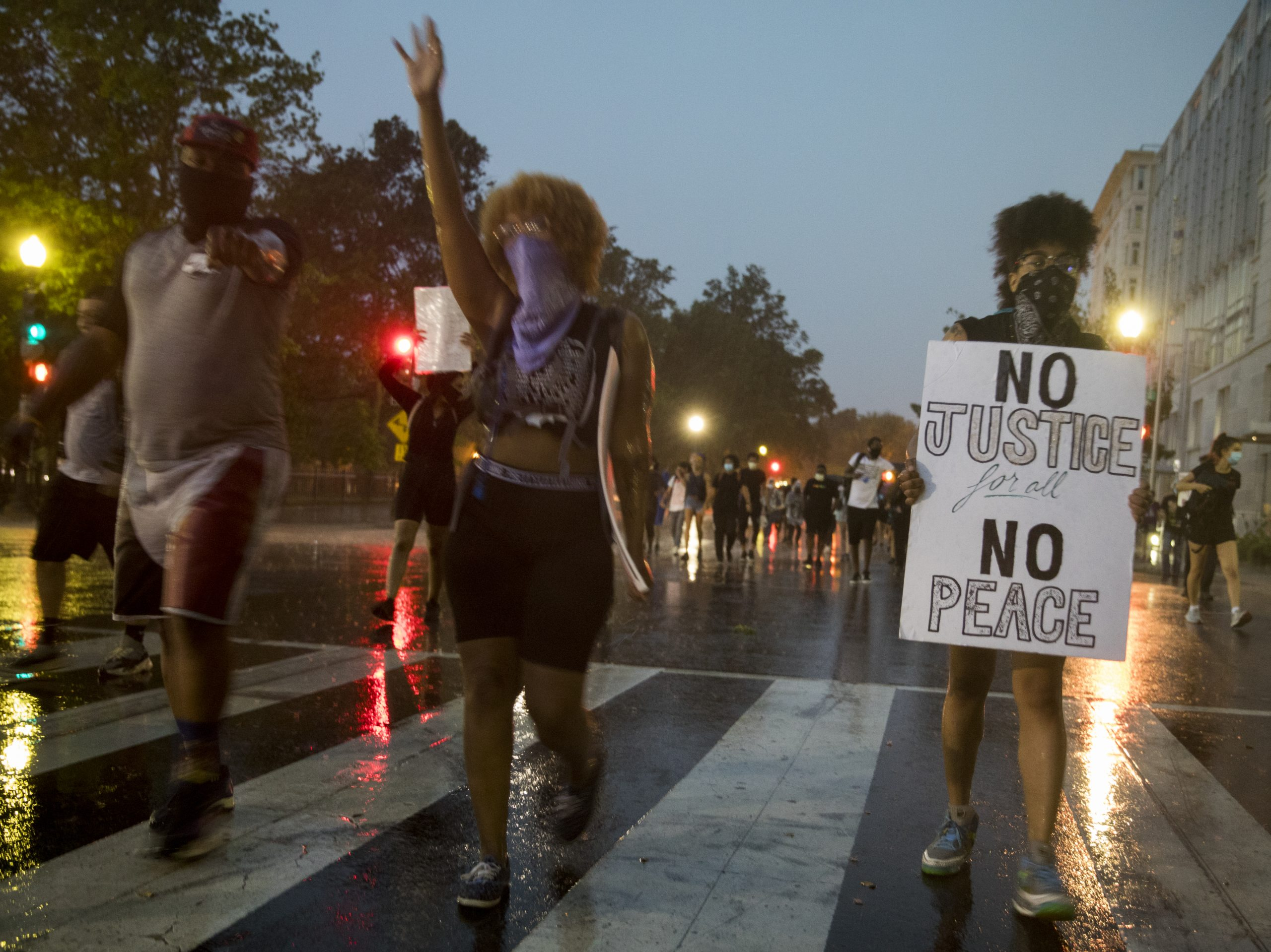 Rain did not dampen the determination of protesters walking on New York Avenue in  Washington, D.C., on Thursday.
