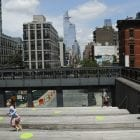 New York City Mayor Bill de Blasio announced that the city will offer free child care to 100,000 students when schools reopen for part-time in-person instruction in September. Here, children play at Manhattan's High Line park on Thursday.