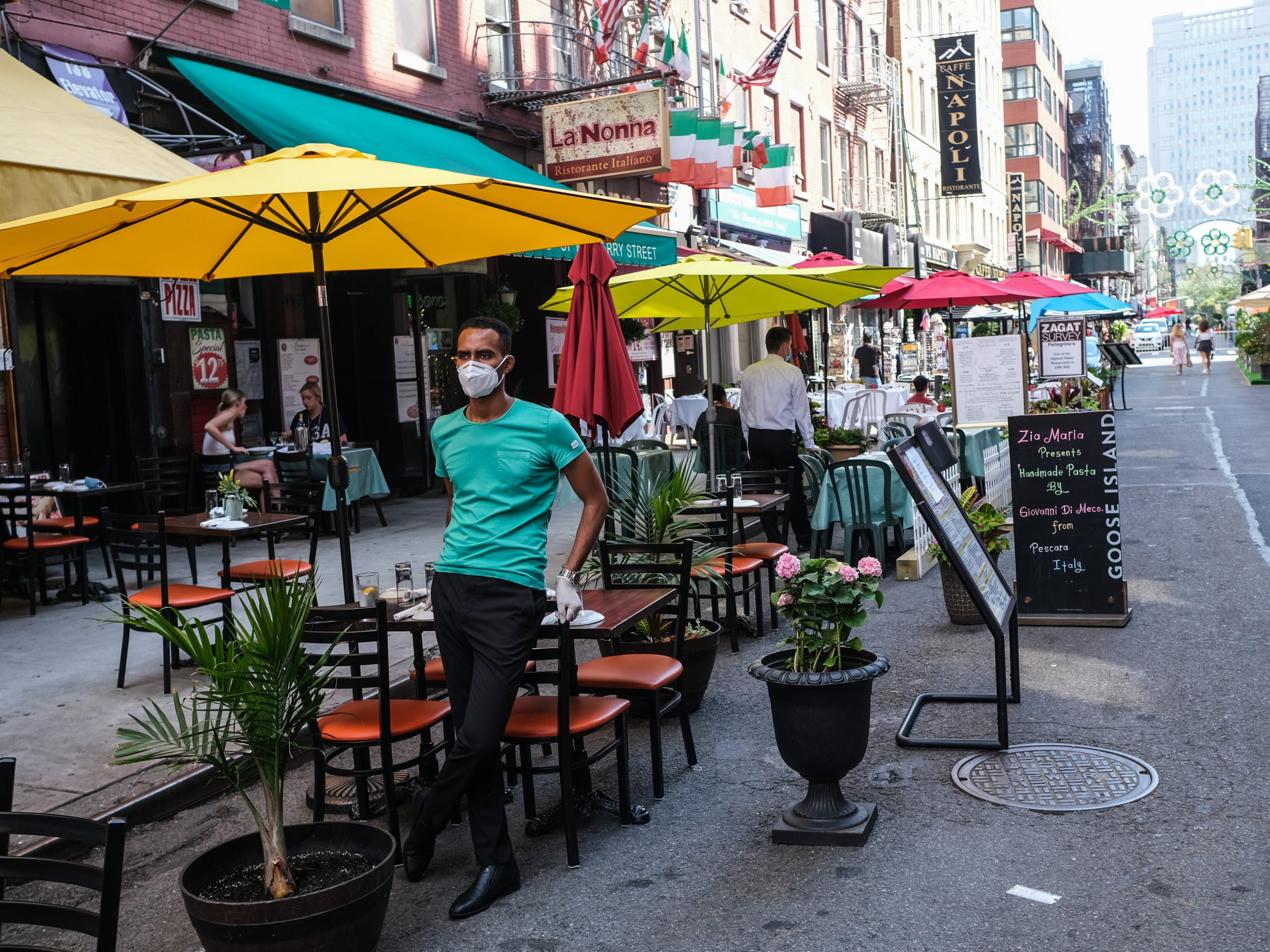 New York City had its first 24-hour period since March without a death from the coronavirus on Saturday. Here, people dine outdoors on July Fourth in Manhattan's Little Italy.