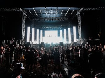 Authorities in New York are investigating after video emerged showing an sizable audience dancing close together at charity concert on Saturday in Southampton, N.Y..