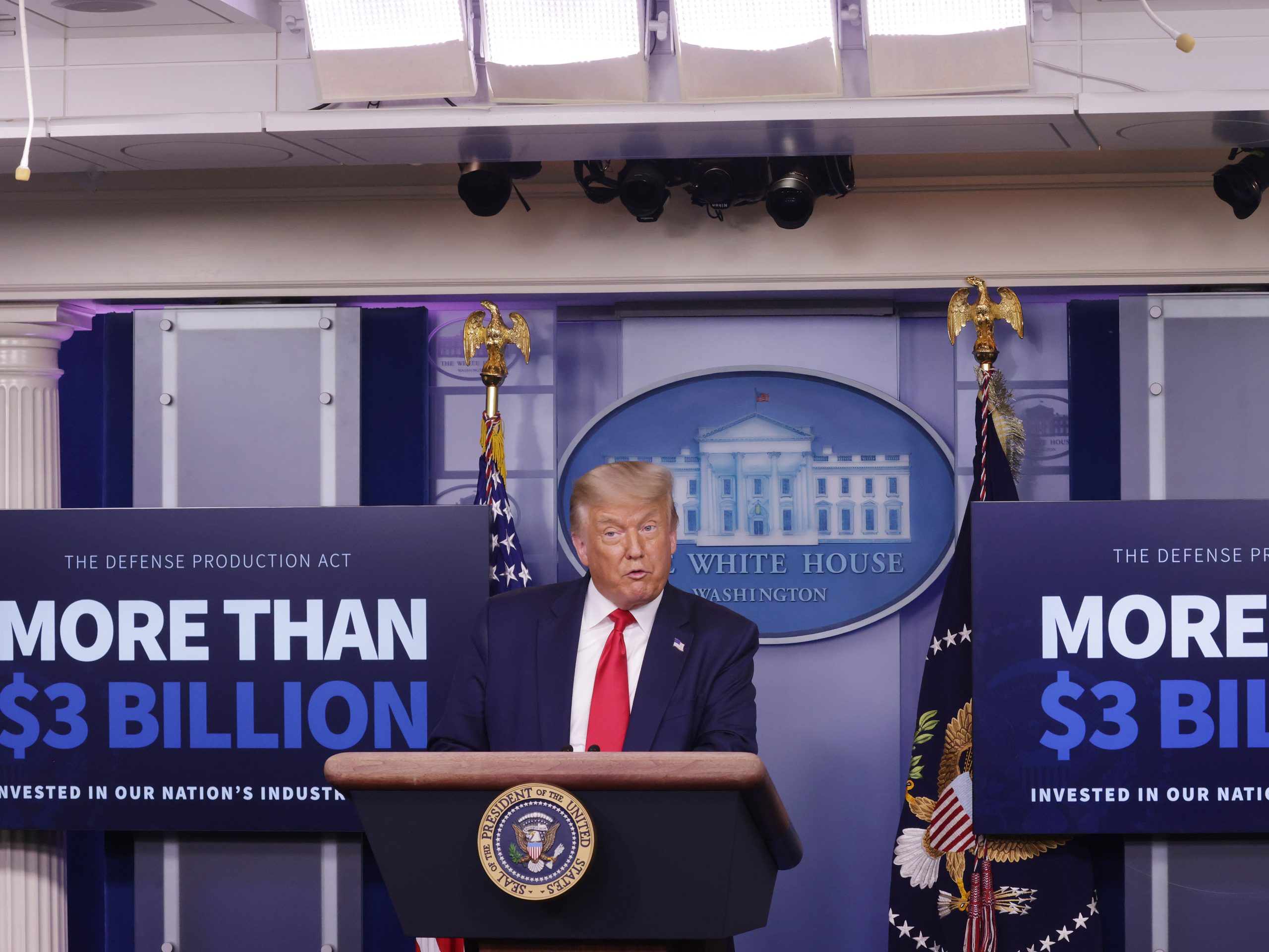 President Trump announces on July 28 that Eastman Kodak will receive a loan to manufacture ingredients used in pharmaceuticals.
