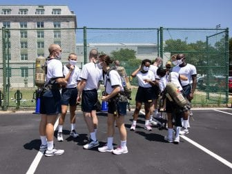Midshipmen participate in a fire safety training on campus in Annapolis.