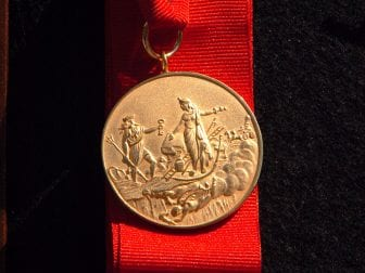 The New York City Fire Department's James Gordon Bennett Medal was established in 1869 and features an image of Neptune (left) wading ashore. It will be renamed the Chief of Department Peter J. Ganci, Jr. Medal.