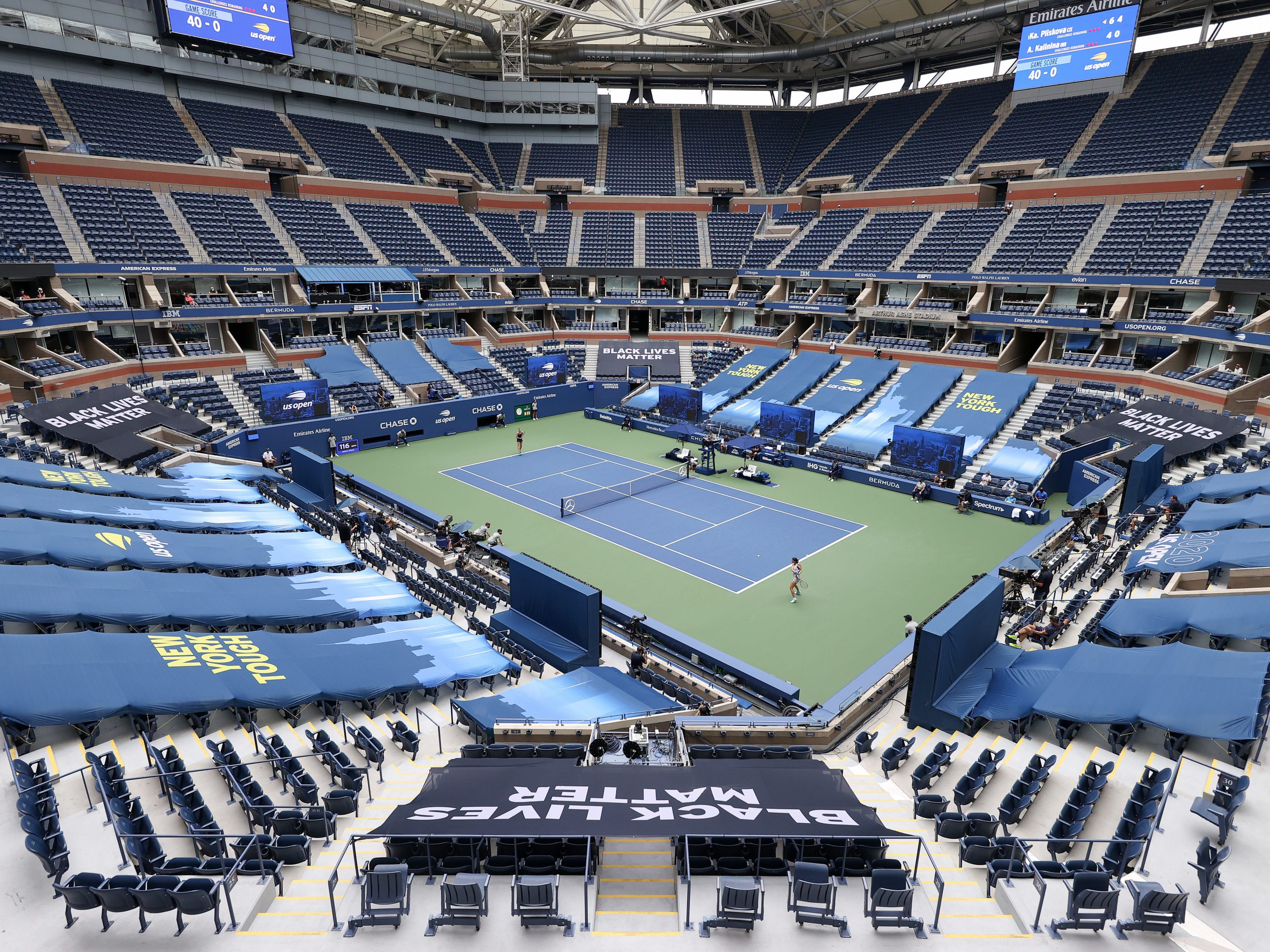 Karolina Pliskova of the Czech Republic and Anhelina Kalinina of Ukraine play their first round match at a mostly empty Arthur Ashe Stadium on Monday. This year's U.S. Open is taking place without spectators because of the coronavirus pandemic.