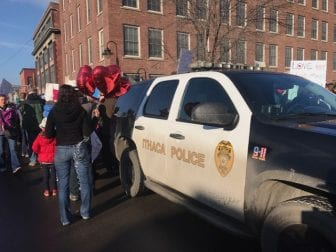 Ithaca Police monitoring a march in the city. (Vaughn Golden/WSKG Public Media)