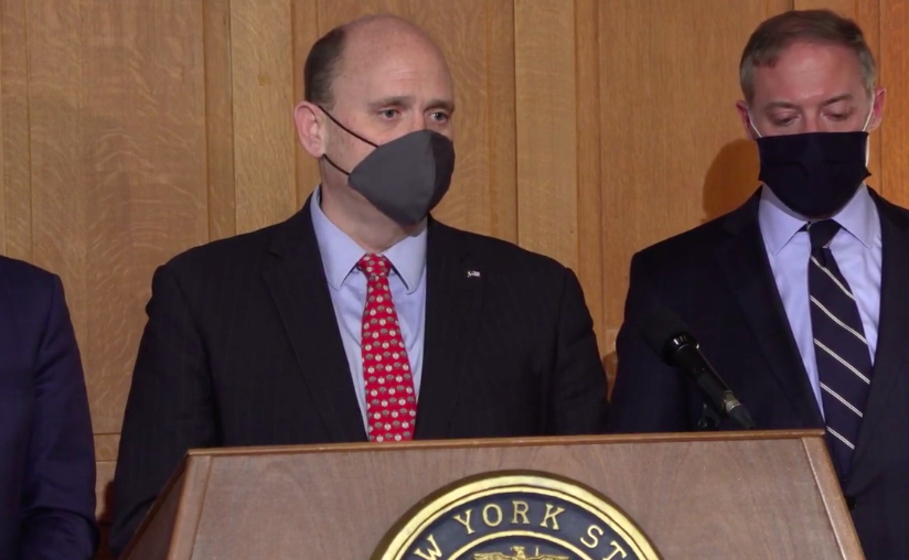 Rep. Tom Reed stands behind a podium at a press conference. (screen grab, Jillian Forstadt/WSKG)