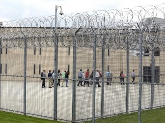 People walk on a tour of the State Correctional Institution at Phoenix in Collegeville, Pa., in 2018. Two brothers who were at the facility have been freed by clemency after expecting to spend their lives incarcerated.