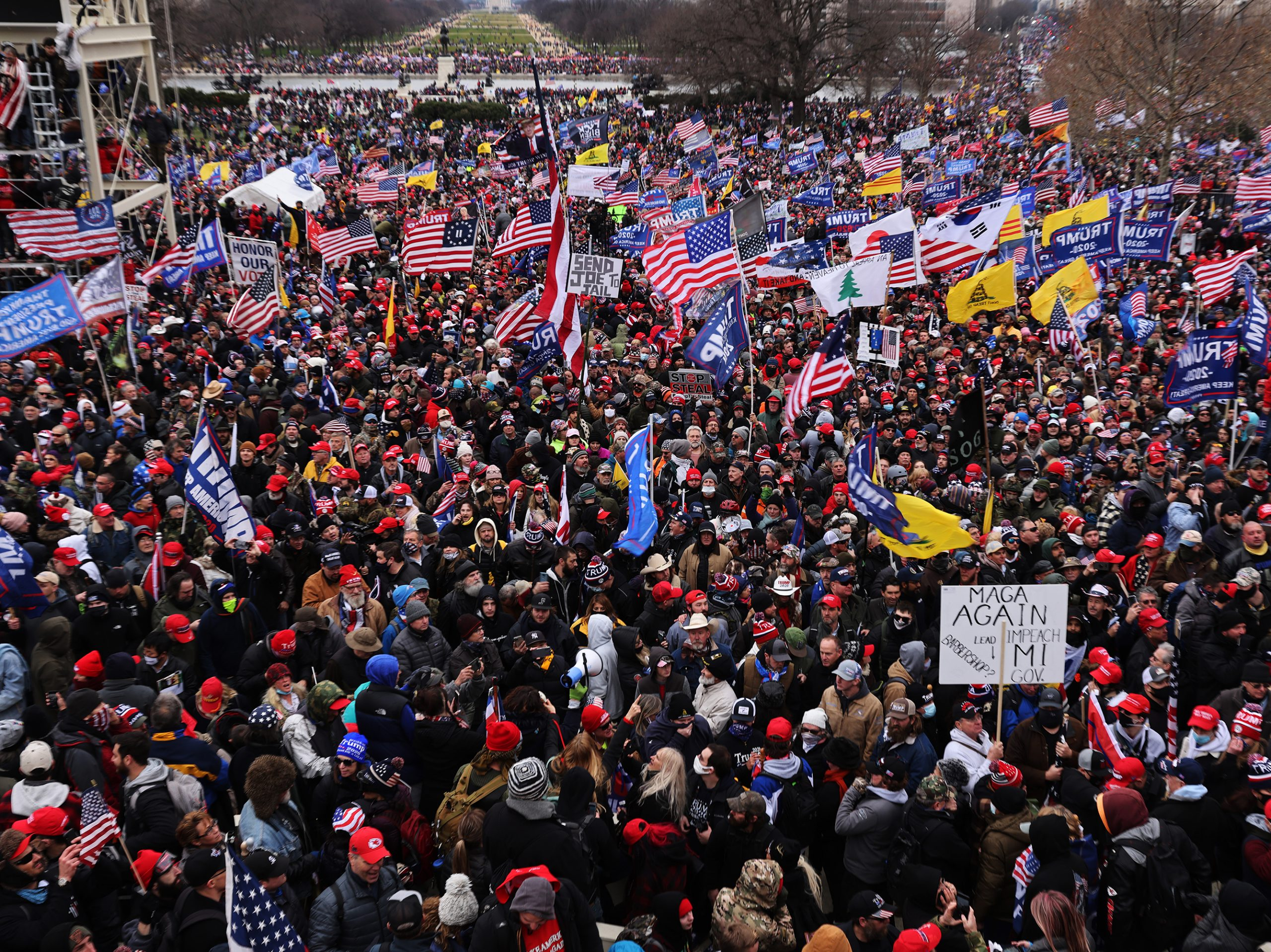 """Thousands of Trump supporters gather outside the U.S. Capitol following a """"Stop the Steal"""" rally on Jan. 6. They stormed the historic building, breaking windows and clashing with police. Nearly two months later some 250 rioters are facing charges, including Richard Michetti of Pennsylvania."""