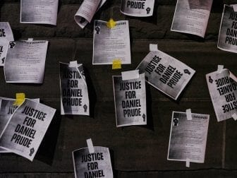 """Signs calling for """"Justice for Daniel Prude"""" were plastered to the exterior walls of City Hall in Rochester, N.Y., on Sept. 8, the seventh consecutive night of protests following the release of bodycam footage showing the March arrest that preceded his death."""