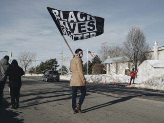 Diallo Payne marches to a small protest outside Rochester Police Locust Club, the police union that represents members of the Rochester Police Department.
