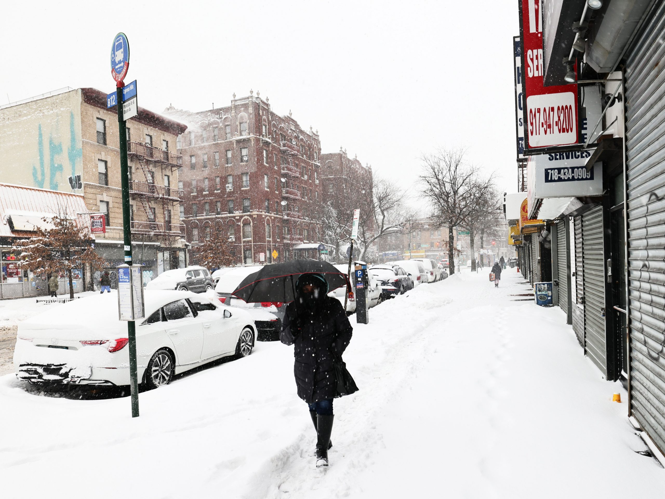 A massive winter storm is bringing heavy snowfall and strong winds to neighborhoods across the Northeast, like this one in Brooklyn, New York.