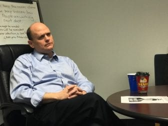 Rep. Tom Reed (R-NY) meets with protestors conducting a sit-in at his office in 2017. (Vaughn Golden/WSKG)