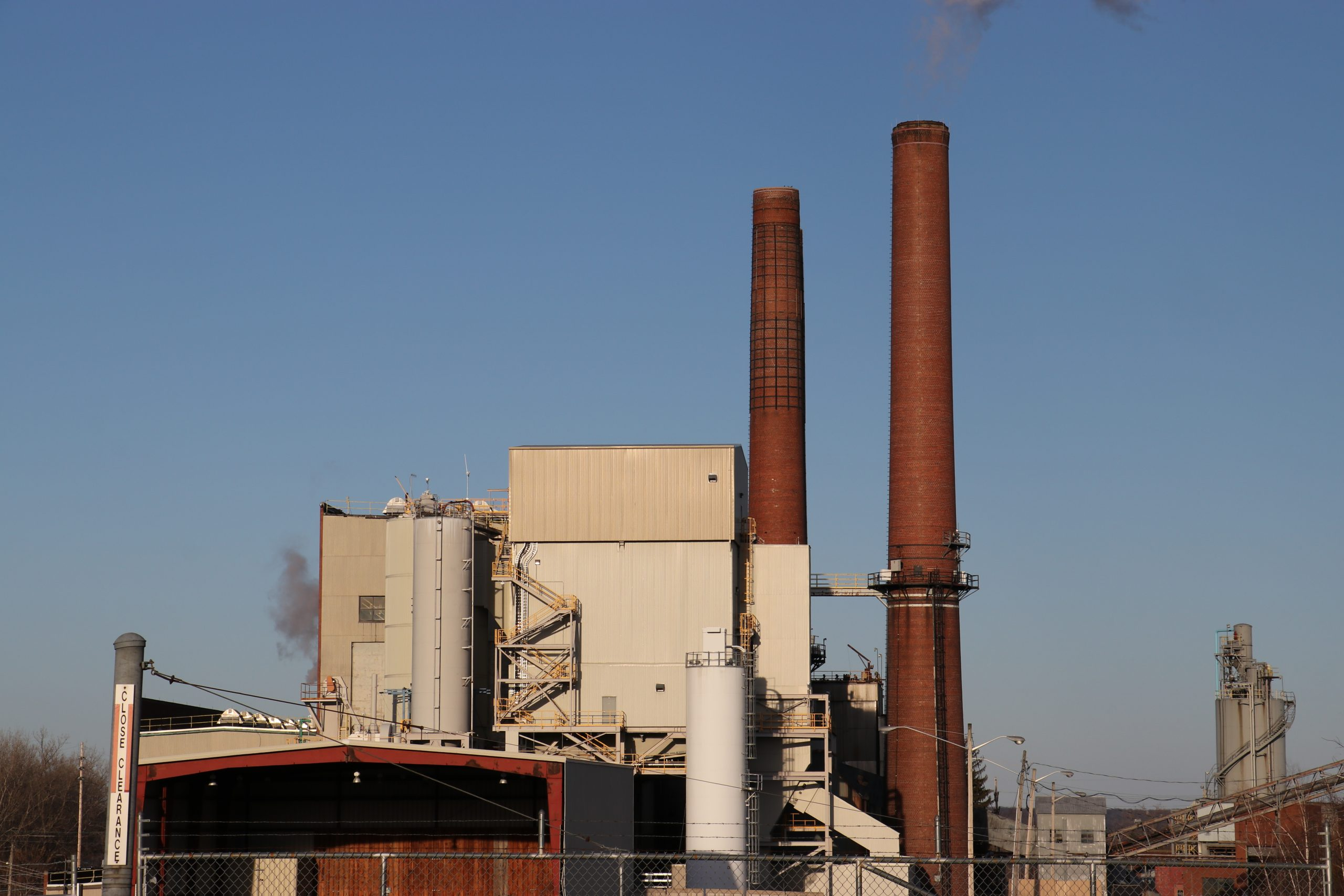 A view of the Greenidge Generation plant with steam billowing from one of two cooling towers