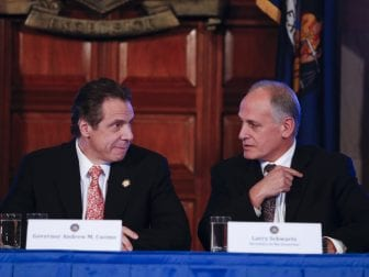 New York Gov. Andrew Cuomo, left, and Secretary to the Governor Larry Schwartz, pictured in 2014. Schwartz is a longtime friend of Cuomo who now directs vaccine distribution in New York state.