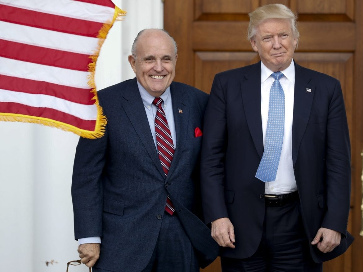 Rudy Giuliani is seen here with Donald Trump in 2016. Federal authorities executed a search warrant on Giuliani's apartment, a person familiar with the matter tells NPR.