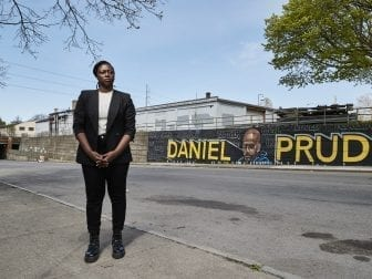 City Council candidate Stanley Martin stands in front of an informal memorial to Daniel Prude in Rochester, N.Y. Prude was a man with mental health and drug issues who died last year after being taken into police custody.