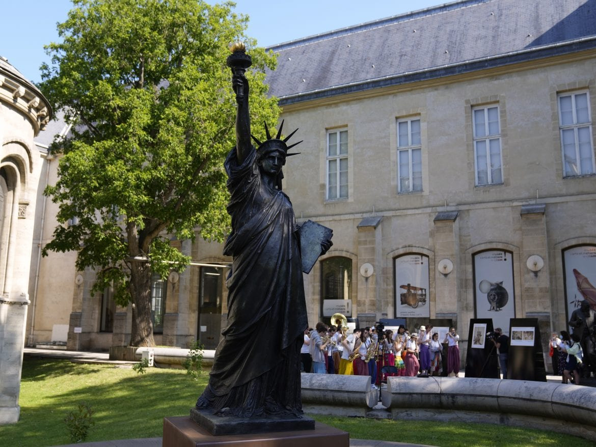 A mini replica of the French-designed Statue of Liberty will reach the U.S. on July 1. Here, the statue awaits its move in Paris on Monday.