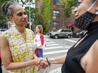 Democratic mayoral candidate Maya Wiley, left, greets a voter during a campaign stop near a polling place in the West Village neighborhood of New York, Tuesday, June 22, 2021.