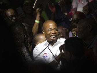 Mayoral candidate Eric Adams mingles with supporters during his election night party, late Tuesday, June 22, in New York.
