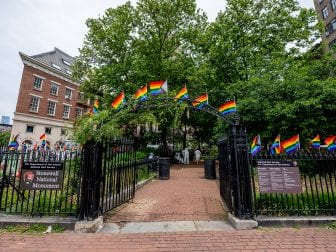Pride flags decorate the Stonewall National Monument at Christopher Park in front of the Stonewall Inn. Many Pride events this year are more subdued due to pandemic precautions.